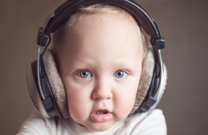 Child listens to music on headphones