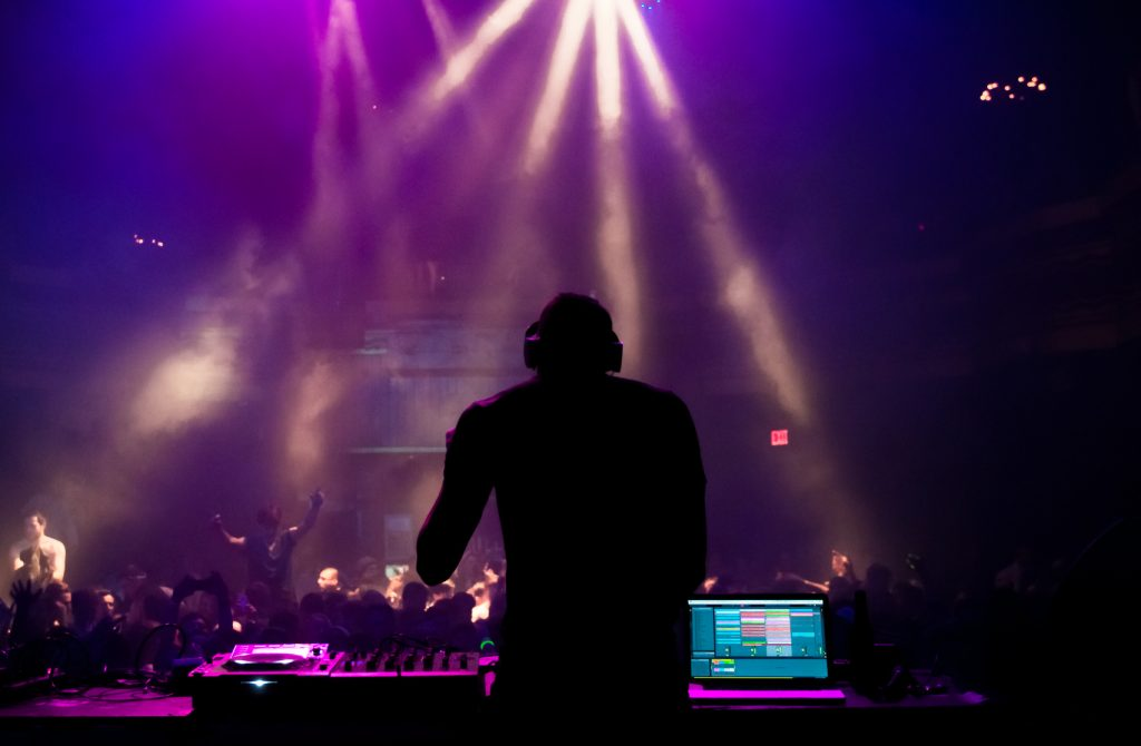 Silhouette of a DJ performing at a concert